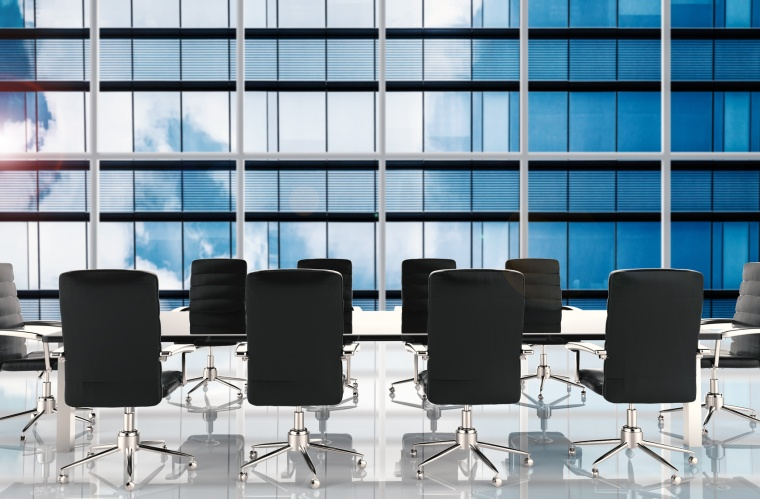 empty conference table and office chairs